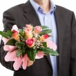 Stock Photo: Mwith bouquet of flowers