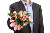 Man with bouquet of flowers — Stock Photo