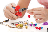 Woman with hand made jewellery — Stock Photo