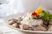Dish with herring and cream — Stock Photo