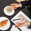 Stock Photo: Businessmwith coffee during explanation