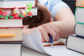 Overworked student sleeping on desk — Stock Photo