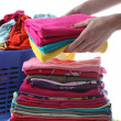 Female folds laundry — Stock Photo #33064203