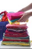 Female folds laundry — Stock Photo