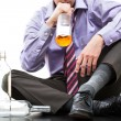 Stock Photo: Drinking alcohol from bottle