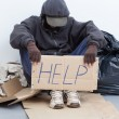 Homeless msitting on street — Stock Photo #33610881
