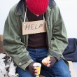 Stock Photo: Homeless eating his meal
