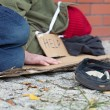 Beggar falling asleep on the street — Stock Photo