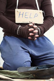 Mendicant begging for help — Stock Photo