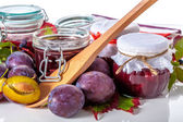Organic plums and jam — Stock Photo