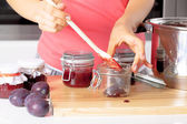 Putting fresh jams into a jars — Stock Photo