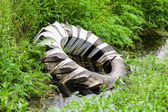 Tyre dumped in forest — Stock Photo