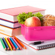 Lunch box and books — Stockfoto