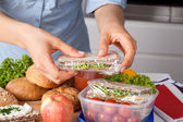 Woman preparing takeaway meal — Stock Photo