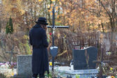 Woman in mourning at cemetery — Stock Photo