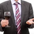 Gentleman holding a glass of wine. — Stock Photo