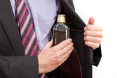 Businessman hiding an alcohol — Stock Photo