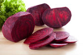 Purple beetroot on wooden board — Stock Photo