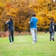 Practicing tai chi in park — Stock Photo