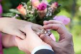 Wedding ring putting — Stock Photo