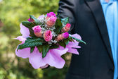 Man with bouquet of roses — Stock Photo