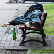 Drunkard on bench — Stock Photo