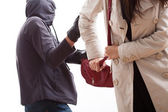 Bandit snatching a purse — Stock Photo