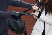 Black backpack stealing — Stock Photo