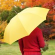 Man with yellow umbrella — Stock Photo