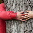 Stock Photo: Couple surrounding tree trunk