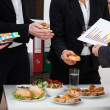 Business consultation during lunch — Stock Photo