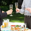 Business party in the garden — Stock Photo