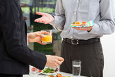 Business discussion with breakfast — Stock Photo