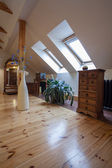 Cloudy home - attic with a pine wood floor — Stock Photo
