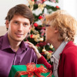 Wishes and christmas present from mother — Stock Photo