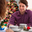 Happy couple during christmas dinner — Stock Photo