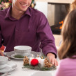 Telling a joke during christmas eve — Stock Photo