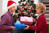 Christmas presents for mother from son. — Stock Photo