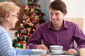 Family conversation during christmas meal — Stock Photo
