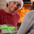 Man giving a present to her girlfriend — Stock Photo #35701427