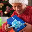 Man in santa's hat just got the present — Stock Photo #35702335