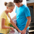 Couple doing the ironing — Stock Photo