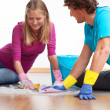 Couple cleaning the floor — Stock Photo