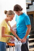 Couple doing the ironing — Stock Photo