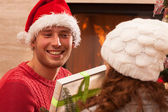 Brother and sister talking about presents — Stock Photo