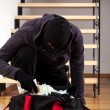 Thief packing the stolen money — Stock Photo