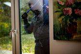 Burglar trying to open the window — Stock Photo