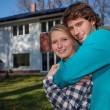 Couple in front of the new house — Stock Photo #35881809