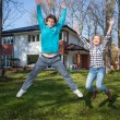 Happy young people with a new house — Stok fotoğraf