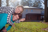 Happy couple with a new house — Stock Photo